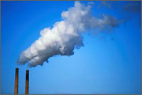 Picture of smokestacks emitting smoke, which pertain to the outdoor air quality indicators for ozone.