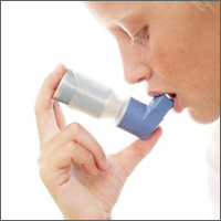 Picture of a person using an inhaler